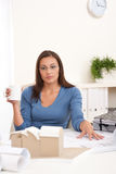 Female architect sitting at office holding coffee Royalty Free Stock Image