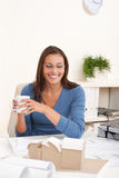 Female architect sitting at office holding coffee Stock Photography