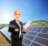 Female architect standing next to solar panels Royalty Free Stock Photos