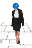 Female Architect Standing Over Blueprint Royalty Free Stock Photos