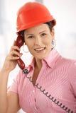 Female architect talking on phone Stock Image