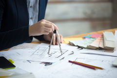 Female architect using drawing compass Stock Image