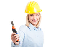 Female architect wearing helmet showing cutter Royalty Free Stock Images
