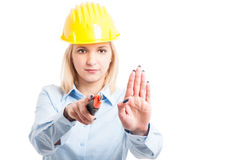 Female architect wearing helmet using cutter tool Royalty Free Stock Images