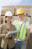 Female Architect And Worker At Site Royalty Free Stock Photography