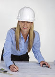 Female architect working on blue prints Stock Photos