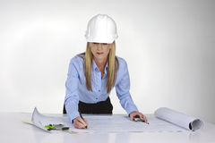 Female architect working on blue prints Stock Image
