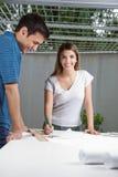 Female Architect Working On Blueprint Royalty Free Stock Photos