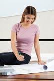 Female Architect Working On Blueprint Royalty Free Stock Photo