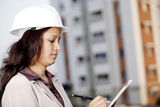 Female architect working at construction site Stock Photos