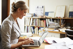Female Architect Working At Desk On Laptop Stock Image