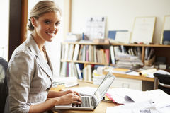 Female Architect Working At Desk On Laptop Stock Photos