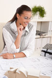 Female architect working at the office holding pen Stock Photos