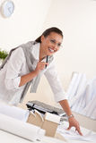 Female architect working at the office holding pen Stock Photo