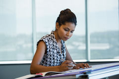 Female architect working in office. Young female architect working in office Stock Photos