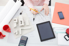 Female architect working in an office Stock Images