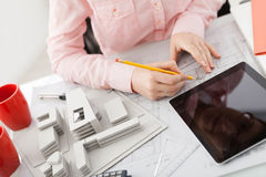 Female architect working in an office Stock Photo