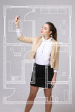 Female architect working with a virtual apartment plan Royalty Free Stock Photography