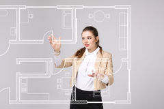 Female architect working with a virtual apartment plan Stock Photos