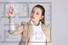 Female architect working with a virtual apartment plan Stock Images