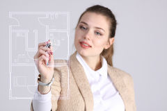 Female architect working with a virtual apartment plan Royalty Free Stock Image