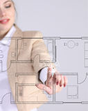 Female architect working with a virtual apartment plan Royalty Free Stock Images