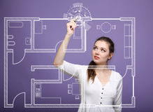 Female architect working with a virtual apartment plan Stock Image