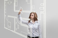 Female architect working with a virtual apartment Stock Photo