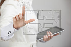 Female architect working with a virtual apartment Stock Photography