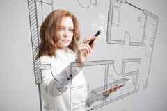 Female architect working with a virtual apartment Stock Photos