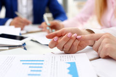 Female arm count on finger while solve and discuss problem Royalty Free Stock Images