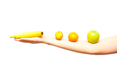 Female arm with different fruits lined up Stock Photo
