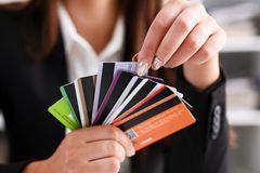 Female arm hold bunch of credit cards. Picking one closeup. Convenient set of funds, budget wallet deposit, wealth and effective investment, invest resources Royalty Free Stock Photography