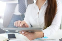 Female arm hold and use tablet pc in office closeup royalty free stock photography