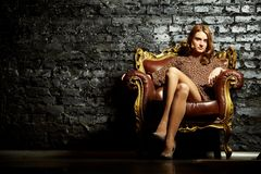 Female in armchair Royalty Free Stock Image