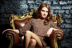 Female in armchair Royalty Free Stock Photography