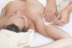 Female armpit depilation in a beauty salon Stock Photography