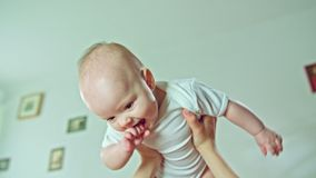 Female Arms Holding a Baby Stock Photos