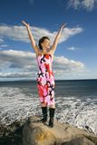 Female with arms outstretched. Stock Photography