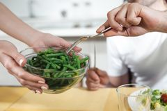 Female arms serving healthy food for husband royalty free stock photo