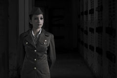 Female Army Personnel. In a dark secret chamber in vintage feel stock photos