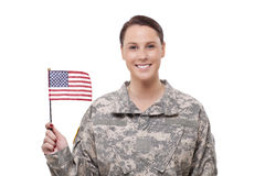 Female army soldier with American flag. Smiling female army soldier with American flag stock image