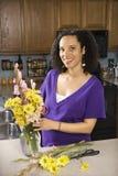 Female arranging flowers Royalty Free Stock Photos