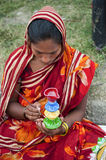 The female artisan of bengal. Woman painting clay pot in local art fair in bengal, India Stock Photos