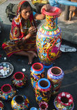 The female artisan. Woman painting clay pot in local art fair in bengal, India Stock Photos