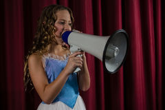 Female artist announcing on megaphone Royalty Free Stock Images