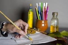 Female Artist With Brush Stock Image
