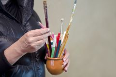 Female Artist With Brushes Royalty Free Stock Images