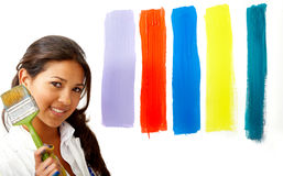 Female artist choosing colours Royalty Free Stock Image