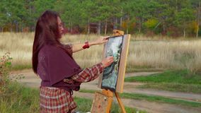 Female Artist Creating A Picture Of Autumn Time stock video footage